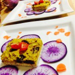 Sauerkraut Quiche with sun dried Tomatoes and sliced purple daikon, sprinkled with carrot confetti. *raw, vegan and gluten free*