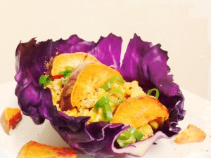 Fiesta Chipotle Corn Salad with roasted Yams, spring onions on a purple cabbage leaf. *organic,vegan and gluten free*
